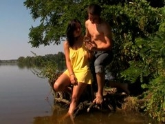 Legal Age Teenager bitch begins satisfying her fuckmate with sex in the lake